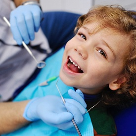 Smiling little boy in the dental chair