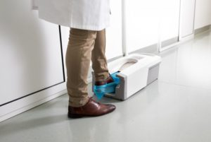 dentist stepping into shoe covering