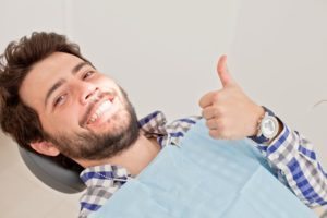 man with a thumbs up needing a root canal
